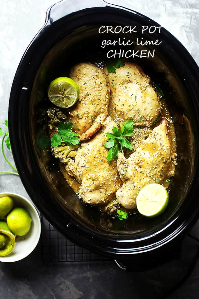 An easy slow cooker chicken breasts recipe! Crock pot simmered chicken in a garlic-lime mixture, cooked to tender perfection. The perfect dinner idea! #chicken #slowcooker #crockpot #chickendinner