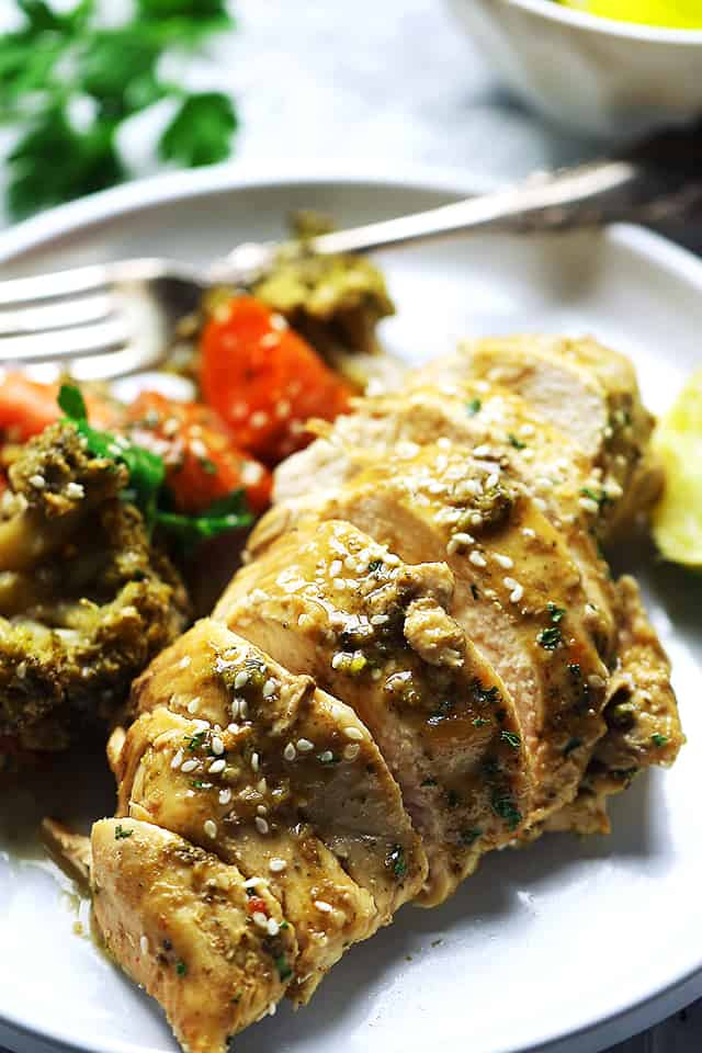 Crock Pot Garlic Lime Chicken - Chicken breasts simmered in an amazing garlic and lime mixture, and cooked to a tender perfection!