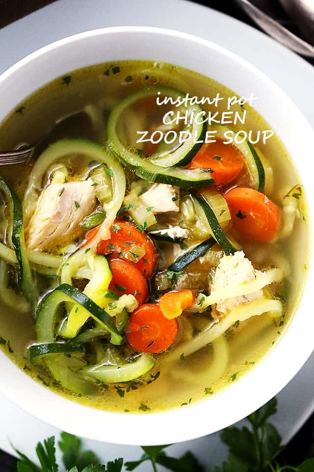 Chicken Zoodle Soup in a white soup bowl.
