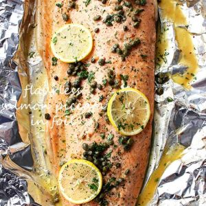 Flourless Salmon Piccata in Foil - A healthy and incredibly delicious dinner with flourless piccata sauce poured over salmon and cooked in foil.