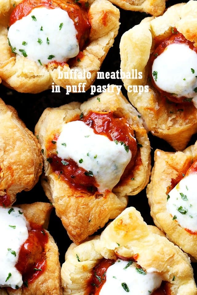 Buffalo Meatballs in Puff Pastry Cups - Delicious buffalo sauce meatballs stuffed inside baked puff pastry cups and topped with blue cheese dressing!
