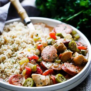 Chicken and Sausage Gumbo - Quick to make, incredibly delicious gumbo loaded with chicken, sausage, okra, peppers, tomatoes, and served over brown rice.