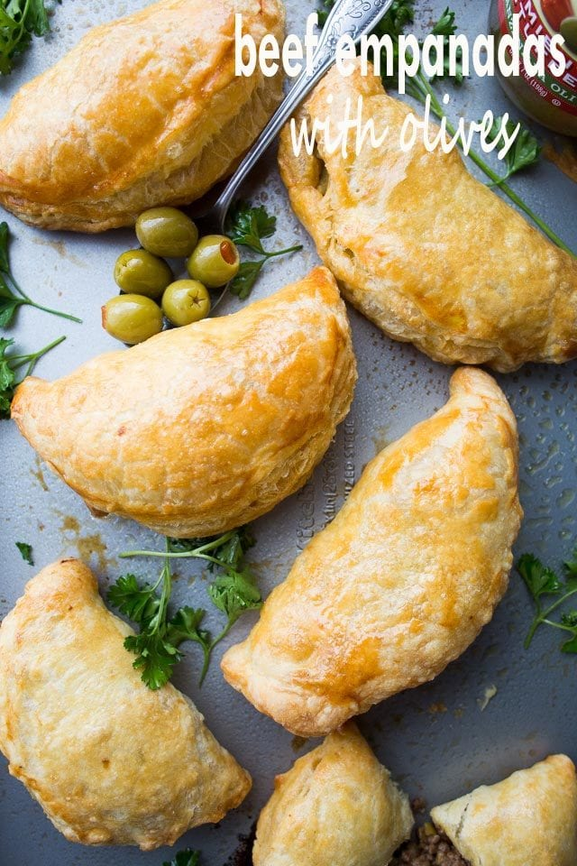 Beef Empanadas with Olives arranged on a tray.