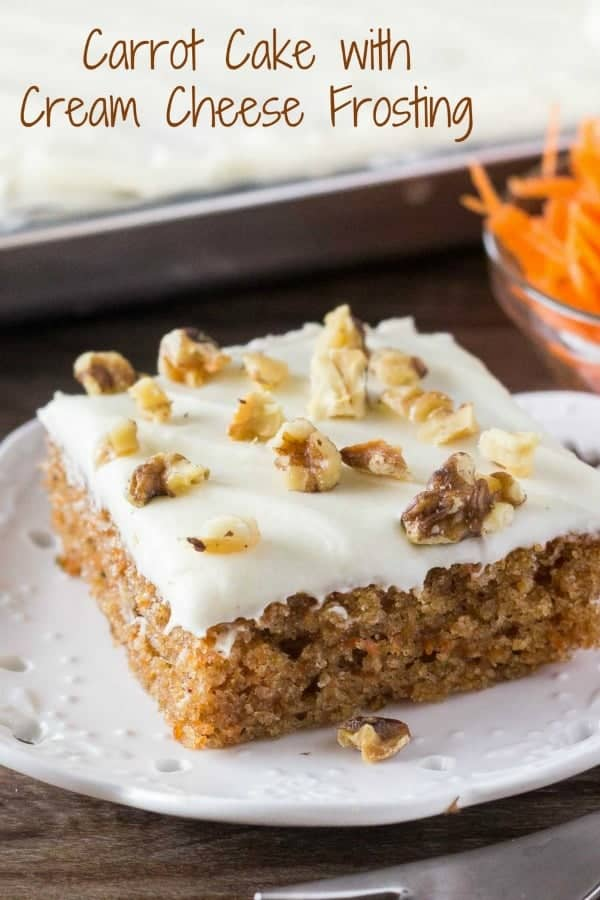 A square of carrot cake with cream cheese frosting