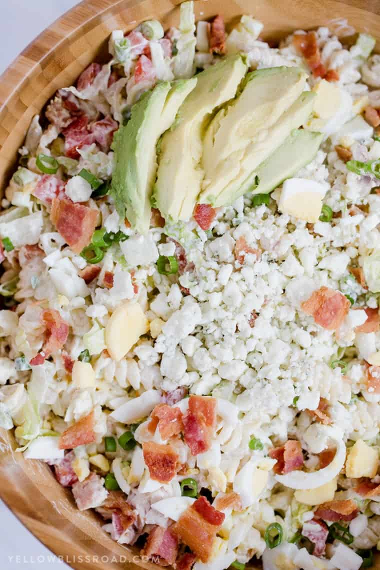 Creamy Cobb Pasta Salad topped with crumbled feta