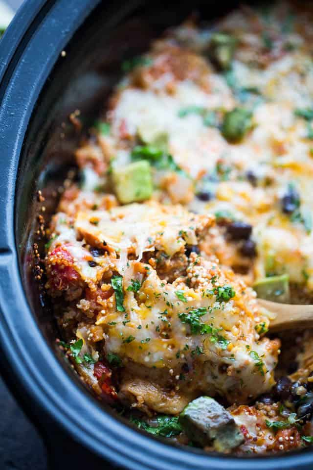 Crock Pot Chicken Quinoa Enchiladas Casserole - Packed with chicken, tomatoes, quinoa, and more, this enchiladas casserole is healthy, delicious, and it's prepared in the crock pot.