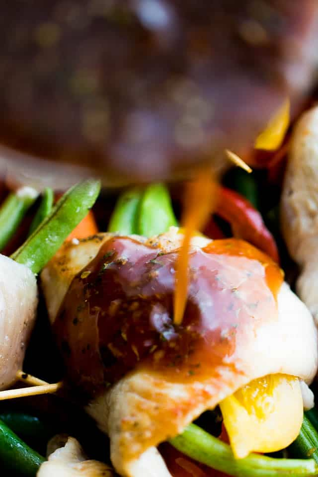 Honey Garlic Chicken and Vegetables Rollups - Quick and easy chicken breast rollups stuffed with colorful vegetables and cooked in an amazing honey garlic sauce.