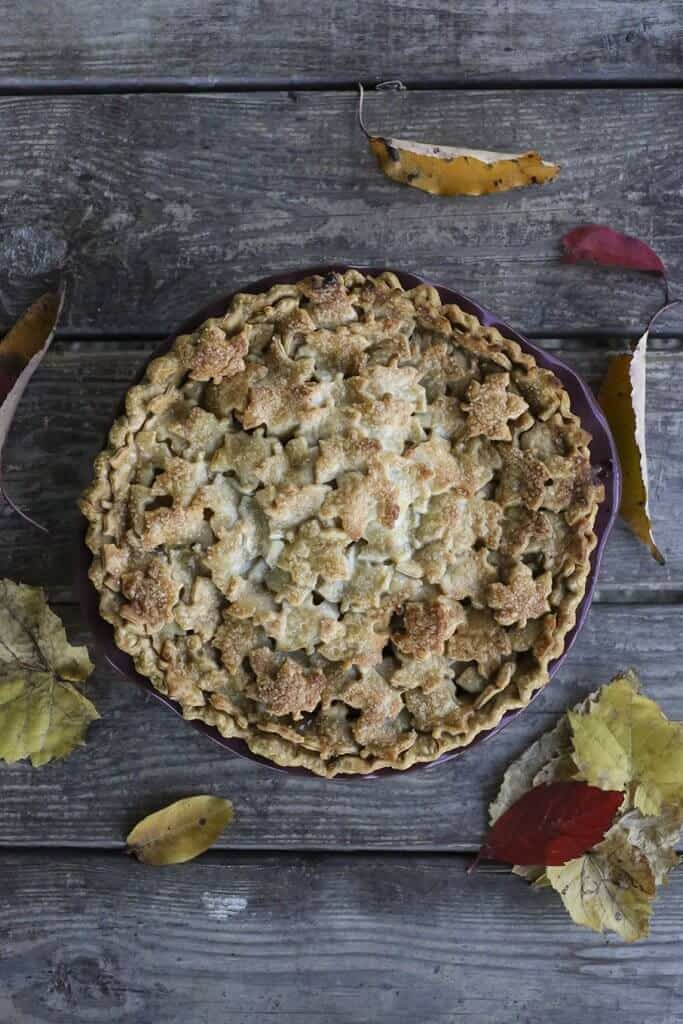Top view of a Maple Chai Apple Pie with decorative leaves on crust