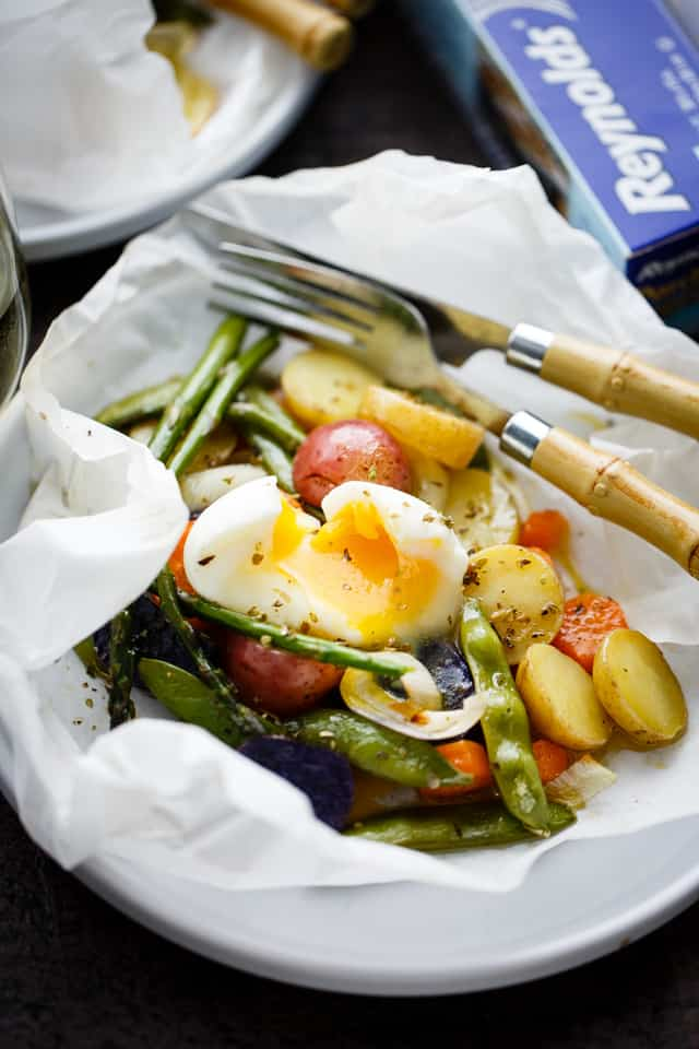 Spring Vegetables and Potatoes Baked in Parchment - Asparagus, snap peas, carrots and potatoes tossed with garlic and olive oil roast up to a deliciously moist and tender perfection inside parchment paper packs. A healthy, fast and real easy must-make-now-side-dish.
