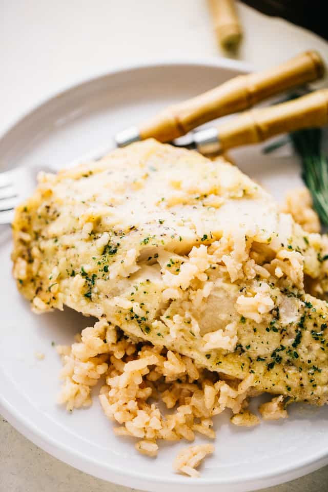 One Pan Risotto with Garlic Herb Tilapia – Delicious, garlicky tilapia set over a flavorful bed of rice, all baked to a creamy perfection!