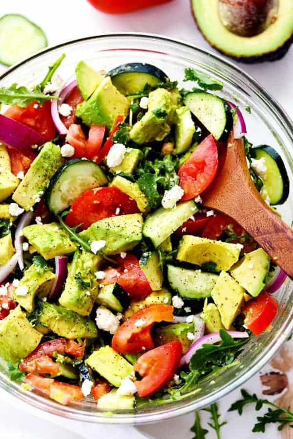 Avocado, tomato, cucumber salad in a serving bowl