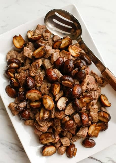 Buttered Steak Bites and Mushrooms on a platter