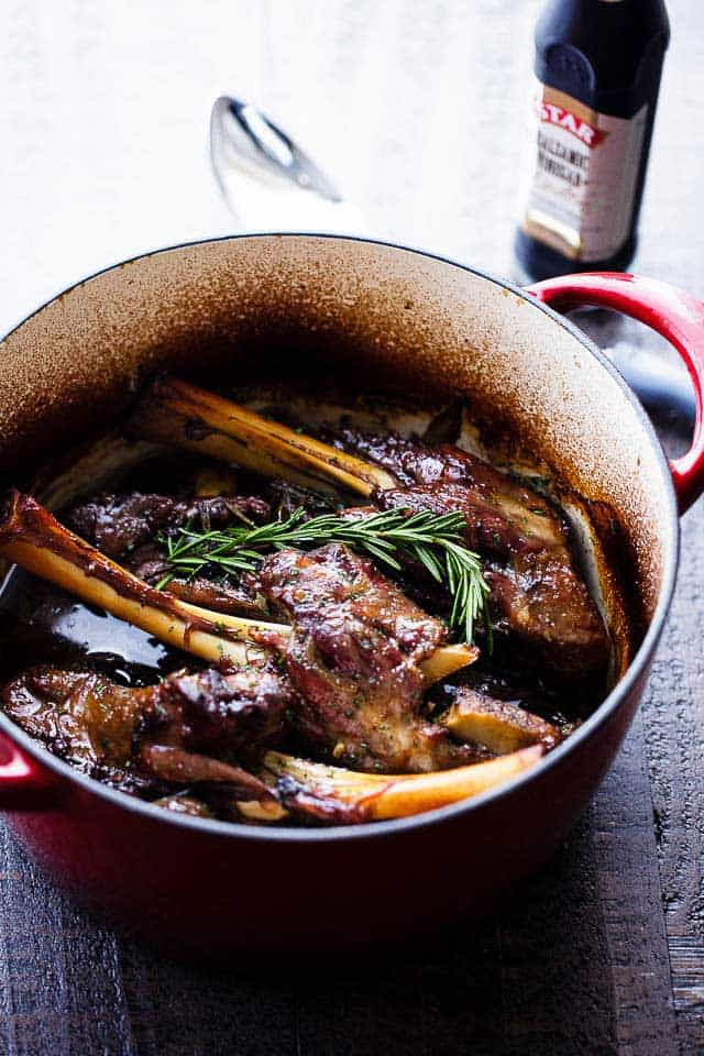 Balsamic Braised Lamb Shanks - A traditional and delicious Easter main dish prepared with lamb shanks slow cooked to a melt in your mouth perfection with balsamic vinegar, wine, garlic and rosemary.