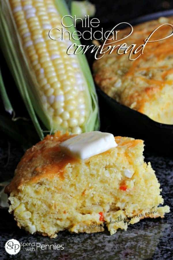 A wedge of Chile Cheddar Cornbread topped with butter