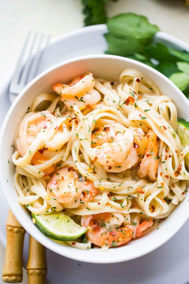 Coconut Lime Shrimp - Deliciously creamy shrimp cooked in an amazing coconut lime sauce and served over noodles or rice.