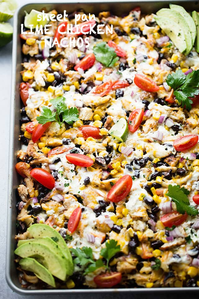 Sheet Pan Lime Chicken Nachos - Easy to make, fun, delicious nachos baked on a sheet pan and loaded with beans, corn, lime chicken, and cheese! Perfect for entertaining a crowd!