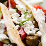 Turkey Meatballs Pita Pockets with Cucumber Yogurt Sauce - Juicy and delicious turkey meatballs served in warm pita pockets filled with a garlicky cucumber sauce and topped with a tomatoes and feta cheese salad.