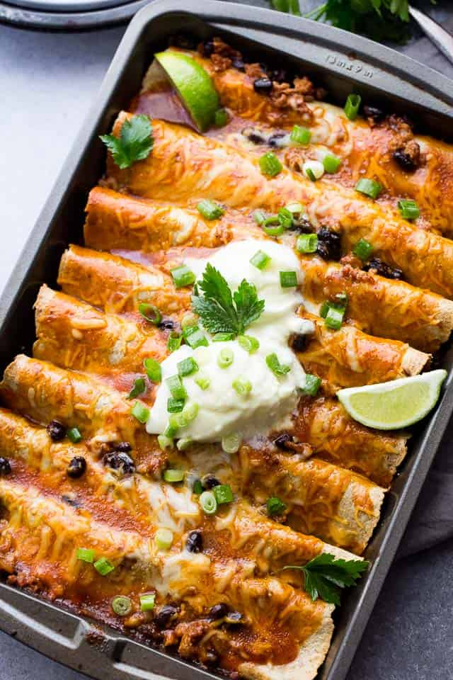 Ground Turkey Black Bean Enchiladas - Loaded with ground turkey and black beans, these saucy, cheesy enchiladas are super easy to make and always everyone's favorite!