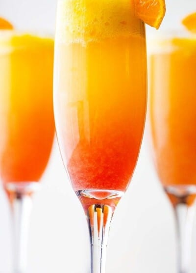 Sunrise Mimosa Recipe - A gorgeous and delicious twist to the classic mimosas prepared with mangos, orange juice, prosecco and liqueur.