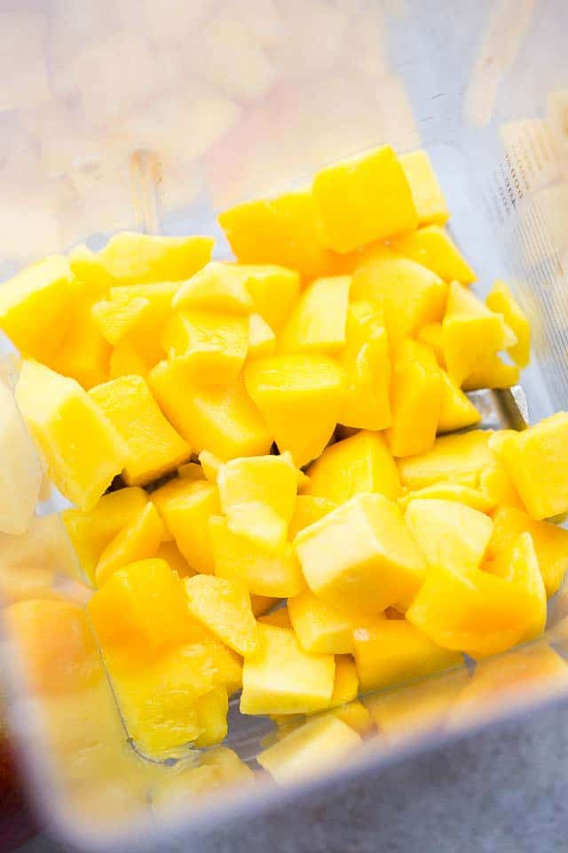 diced mangoes in a blender.