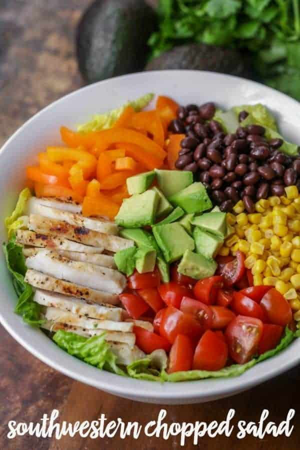 Southwest chopped salad with sliced chicken, beans, and colorful vegetables