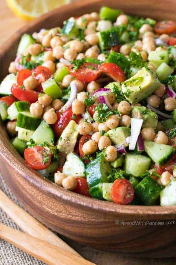 Chickpea salad with cucumbers and tomatoes in a serving bowl