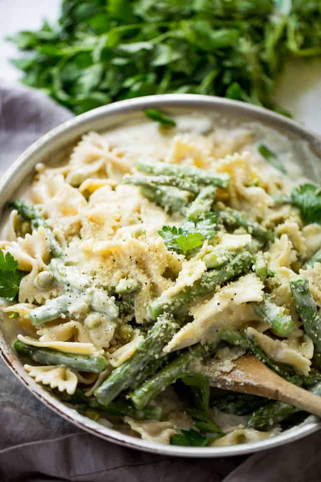 Creamy Vegetable Pasta Recipe - A creamy, yet healthy veggie loaded protein-packed pasta with asparagus and peas, all tossed in a lightened-up cream sauce!