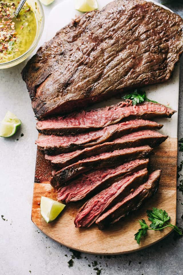 Grilled Flank Steak with Avocado Chimichurri Sauce - Deliciously juicy grilled flank steak served with an amazing blend of avocado and chimichurri sauce!