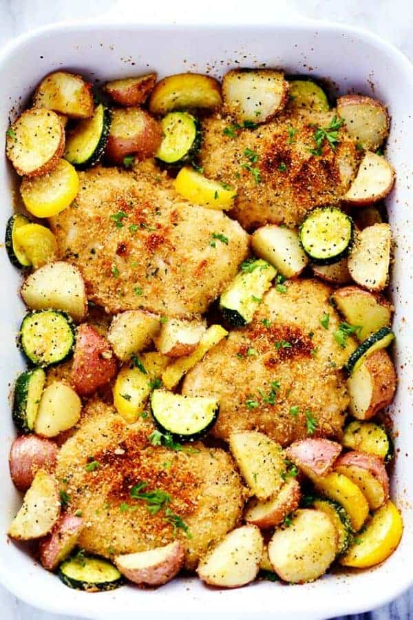 A sheet pan of crispy parmesan garlic chicken and vegetables