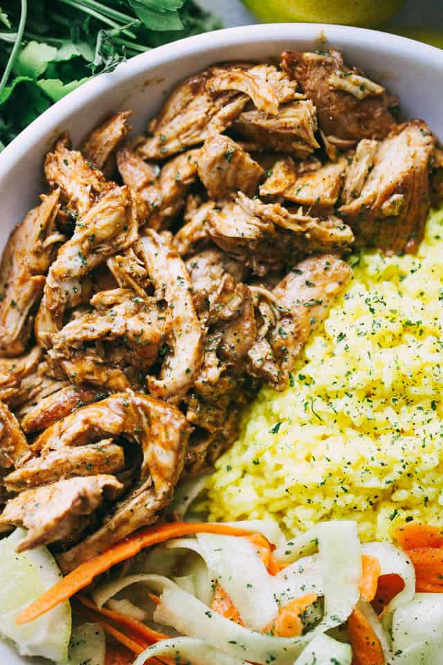 Pulled Tandoori Chicken Rice Bowls - Deliciously juicy chicken breasts cooked in tandoori marinade and served over flavorful lemon rice and a cucumber salad.