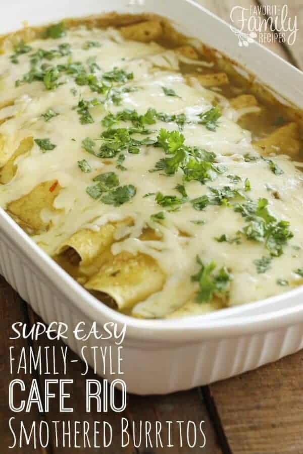 Super Easy Family-Style Cafe Rio Smothered burritos in a baking dish topped with melted cheese and scallions