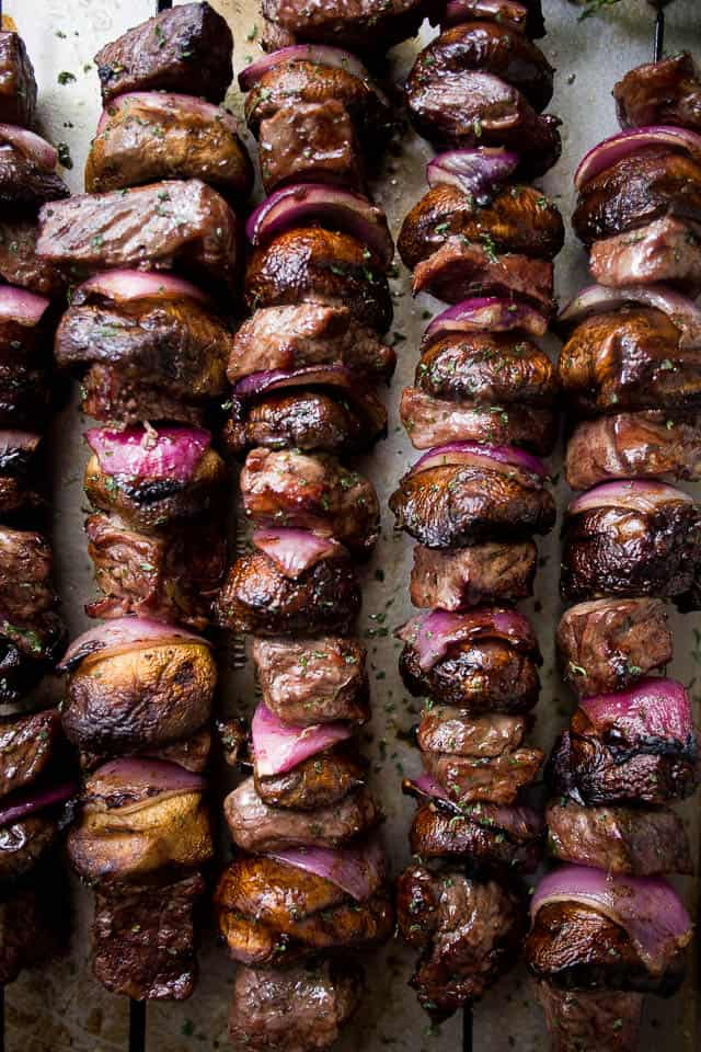 Steak and Mushroom Kabobs with Mint Yogurt Dip - Deliciously marinated steak kabobs with mushrooms and red onions grilled to a tender perfection and served with an amazing mint yogurt dip!