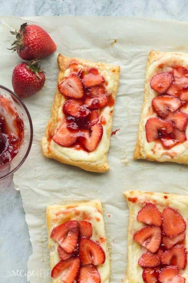 Rectangular Strawberry Cream Cheese Danishes on parchment paper