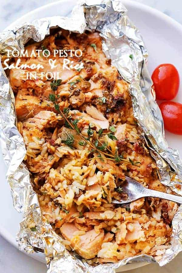 Top view of Tomato Pesto Salmon and Rice in foil