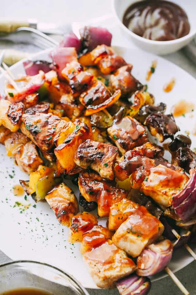 Barbecue Pineapple and Pork Skewers served on a plate.