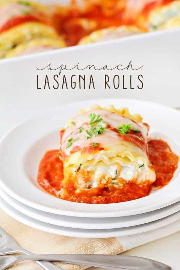 A cheesy Spinach Lasagna Roll in a bowl with tomato sauce and melted cheese