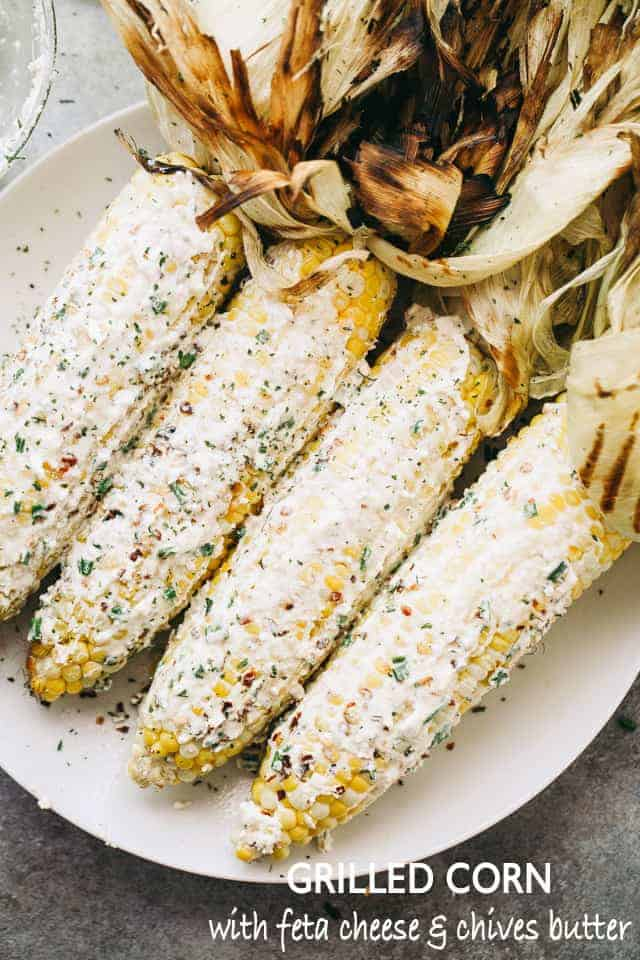Grilled Corn with Feta Cheese and Chives Butter - Delicious and juicy grilled corn on the cob smothered with a creamy feta cheese compound butter!