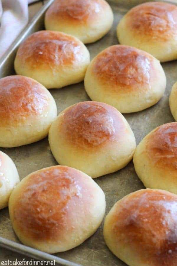 A dozen round Perfect Soft and Buttery Rolls on a baking sheet