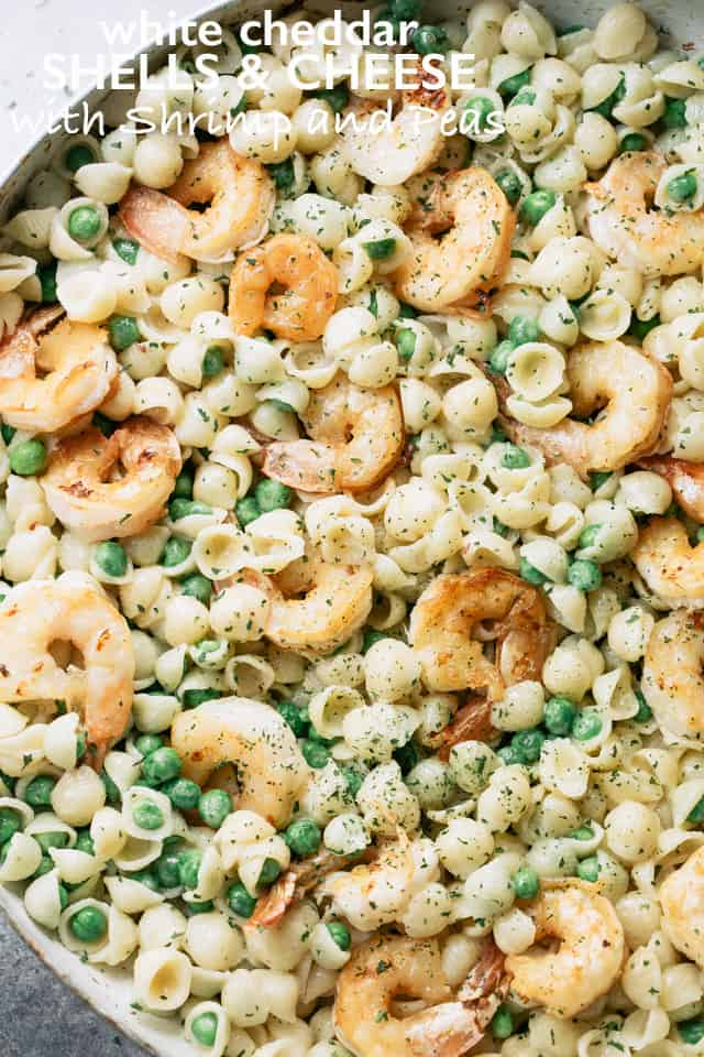 White Cheddar Shells and Cheese with Shrimp and Peas - Made with lightened up creamy white cheddar cheese sauce, pasta shells, and sweet peas, Shrimp Shells and Cheese puts a new spin on ordinary mac 'n cheese and the whole family will LOVE it!