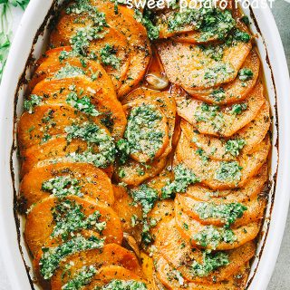 Sweet Potato Roast with Parsley Pesto - Tender, extra-flavorful roasted sweet potatoes with olive oil, a touch of butter, fragrant berbere spice, and topped with the most delicious parsley pesto.