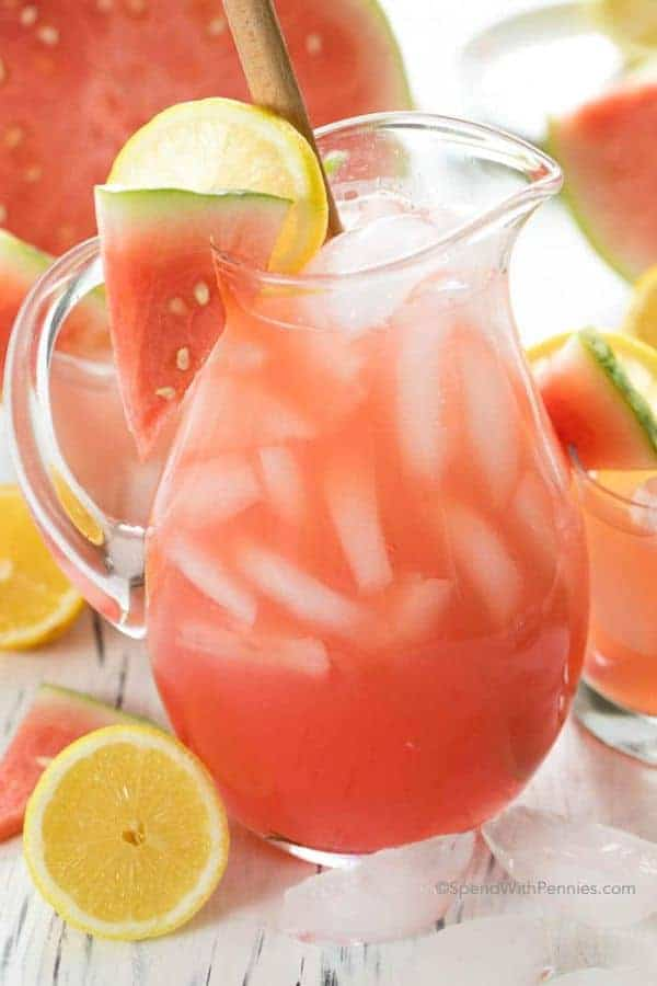 A glass pitcher of Watermelon Lemonade with ice