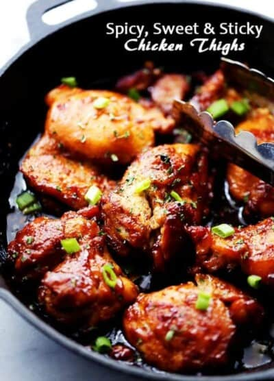Spicy, Sweet and Sticky Chicken Thighs - An easy and quick one skillet meal including sticky, tender and delicious chicken thighs rubbed with a homemade spice rub and brushed with an amazingly sweet honey sauce.