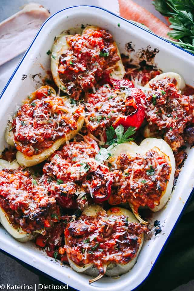 Bolognese Stuffed Peppers - A flavorful bolognese inspired filling prepared with ground meat, bacon, cheese, and seasonings stuffed into bell peppers and roasted to a delicious perfection!