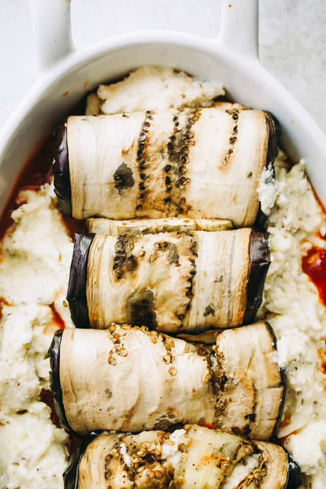 Eggplant Rollatini - Eggplant rollups stuffed with a cheesy ricotta blend, and baked in a delicious marinara sauce.