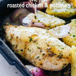 One Pan Roasted Chicken and Potatoes - Quick and easy one pan dinner recipe with chicken coated in a sweet and savory honey mustard sauce and roasted alongside seasoned and incredibly flavorful potatoes and red onions.