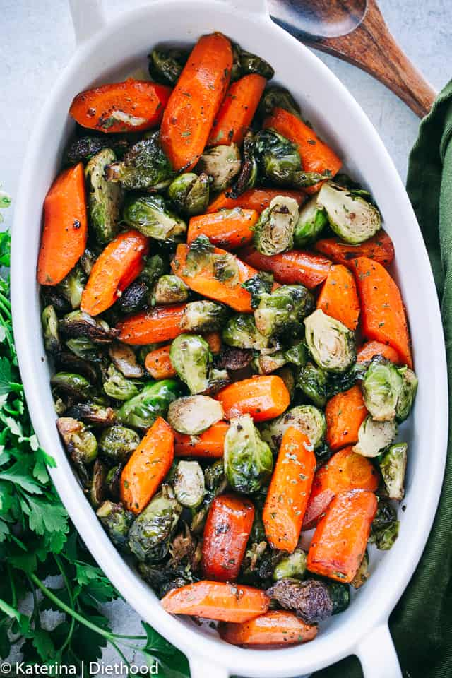 Garlic Brown Butter Roasted Brussels Sprouts and Carrots - Incredible Holiday side dish with brussels sprouts and carrots tossed in garlic brown butter and roasted to a delicious perfection!