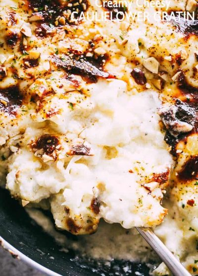 Creamy Cheesy Cauliflower Gratin - Lightened up, no-cream creamy cauliflower gratin that's so easy to prepare and makes for one delicious Holiday side dish recipe!