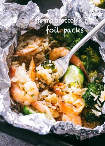 Shrimp Foil Packets with Broccoli and Rice - These foil packets are loaded with shrimp, broccoli and rice tossed in a delicious Asian inspired sauce, and they make for a quick, easy dinner packed with flavor!