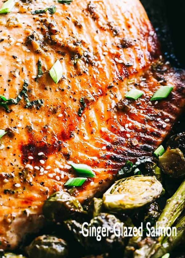 Ginger Glazed Salmon with Asparagus and Brussels Sprouts - A slightly sweet, but spicy and incredibly flavorful ginger-glaze creates this irresistible salmon dish that is very simple to prepare and comes together in about 30 minutes!