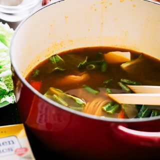 Easy Chinese Hot Pot Recipe - A simple take on the traditional Chinese Hot Pot prepared with a warm and spicy broth chock full of veggies, noodles, and chicken.